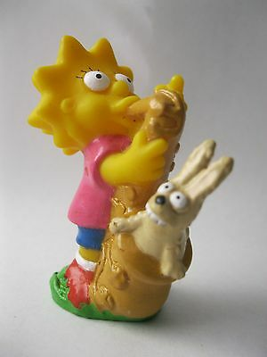 LISA SIMPSON BLASTING BUNNY OUT OF SAXOPHONE stamp 1990 soft vinyl toy 2.5 inch