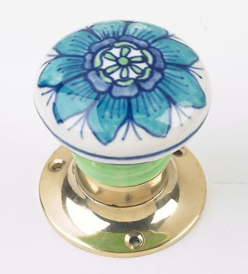 Pair Of Blue and White Flower Door Knobs With Polished Brass Backplates