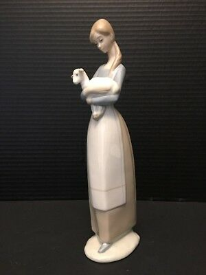 "Lladro Figurine Woman Holding Lamb. 10"" Tall"