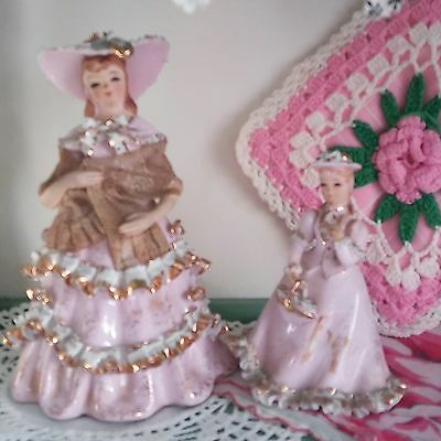 pair of pink and gold vintage lefton ceramic lady figurines