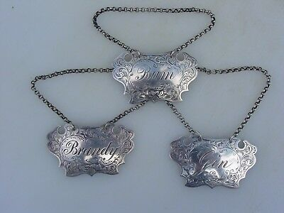 Set of three Antique Sheffield sterling silver escutcheon decanter labels