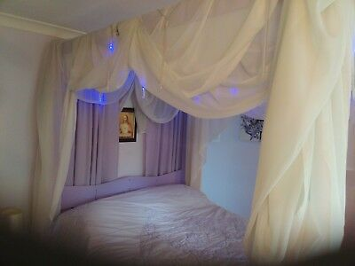 Four poster double bed frame with 27 yards of drapes