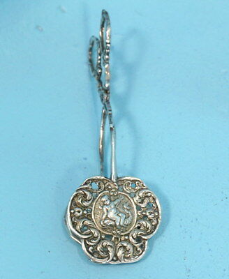 130g Antique German Sterling Silver Cookie Tongs Putti Rides Fish Cherubs Relief