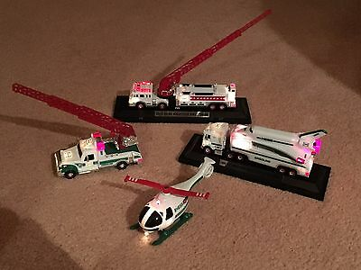4 Hess Truck Miniatures Great Condition with lights, motion 2005, 2007, 2009-10