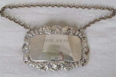 "A Fine Silver Plated Decanter Label Engraved "" Derby Awards 1997 Flat Jockey""."