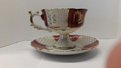 Royal Crown bone China gold trim teacup and saucer