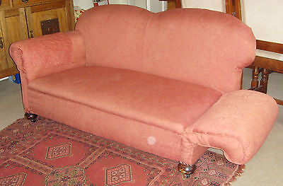 settee - drop end two seater settee on ball feet recovered in salmon pink fabric