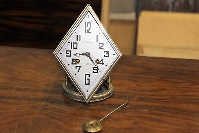 French Art Deco Movement Or Mecanique With Pendulum Clock Circa 1940s . AS  IS