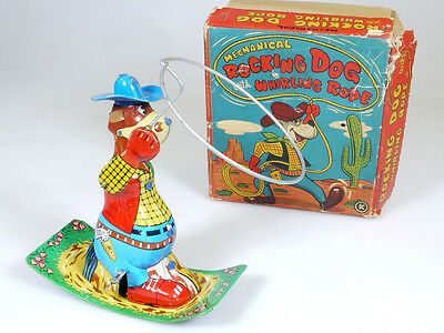 K Rocking Dog Mechanical Whirling Rope Cowboy Blech Japan OVP 1402-21-07
