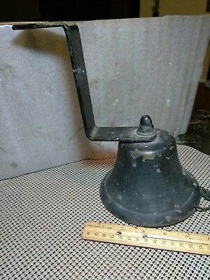 A Vintage Brass Or Bronze Bell With A Cast Iron Bracket. Bell Has Large Crack