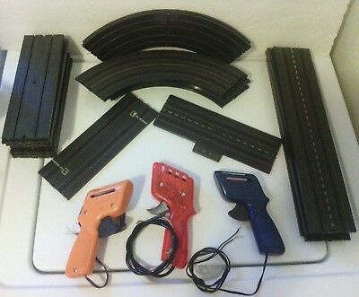 "27 pc Aurora slot car track with 3 controllers. see descrip for part #s ""AS/IS"""