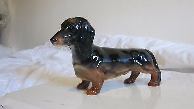 Beswick DACHSHUND standing 3013. With a chip to one foot, but not very visible.