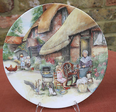 """Royal Doulton  """"The Spinner"""" from the Old Country Crafts series"""