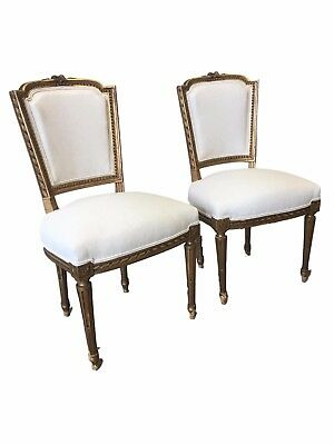 Pair of French Antique Louis XVI Style Parcel Gilt Side Chairs