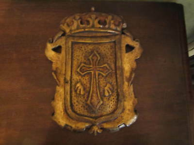 A very old carved giltwood armorial crest