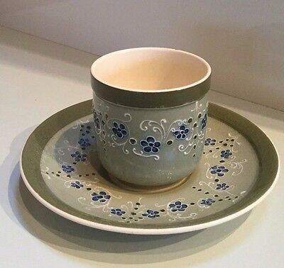 An early Moorcroft Macintyre art pottery cup and saucer. Florian Forget-me-nots