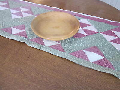 """Old quilt made into table runner.Farm table size 64"""". Prints in Pink on green."""