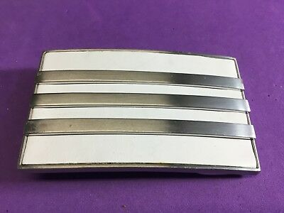white silver Adidas belt buckle - shoes company logo