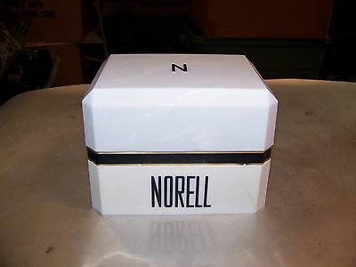 VINTAGE opened Norell body powder 6 oz.