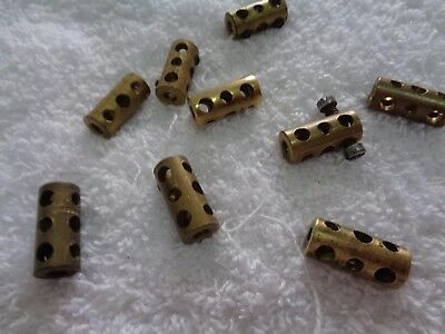 9 vintage Meccano couplings. Part 63?