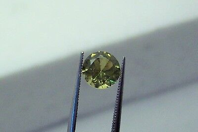 lab created stunning beautifully green sapphire 5.8 mm round faceted carat 0.65