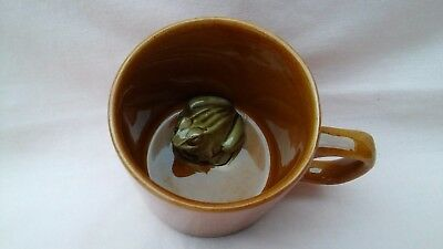 Vintage Small Ceramic Mug In Brown With A Little Ceramic Green Frog Sitting In.
