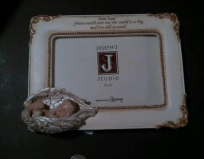 Roman baby in wings photo frame