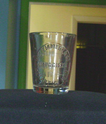 Druggist Or Pharmacy Dose Glass Cup Atlantic Iowa Ia Vic. Emmert & Co. Druggists