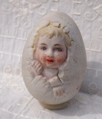 Bisque Child in Egg