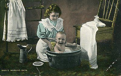 """Postcard """"Baby's morning bath"""" posted NOTTING HILL with dplx 1903"""