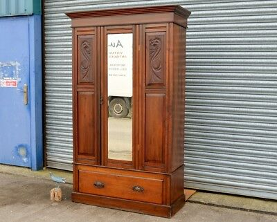 Antique Mahogany Wardrobe with Carvings And Bottom Drawer.