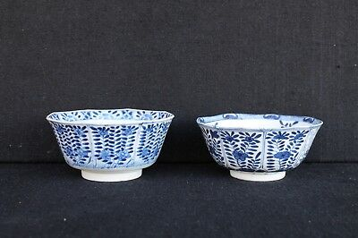 Two large blue white Chinese export bowls with floral decoration and Kangxi mark