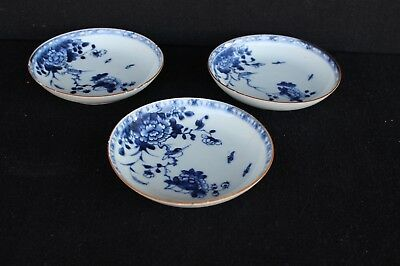 Three 18th century Chinese saucers with decoration of bird in garden
