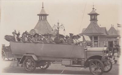 RP CHARABANC MOTORBUS OUTSIDE EASTBOURNE PIER SUSSEX  REAL PHOTO c1910