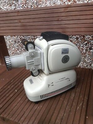 Retro style slide projector Noris Trumpf with case, but needs bulb.