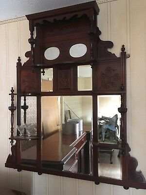 Antique carved wood mirror with small shelves