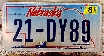 Nebraska Conestoga Covered Wagon on the Plains License Plate with a 2011 Sticke