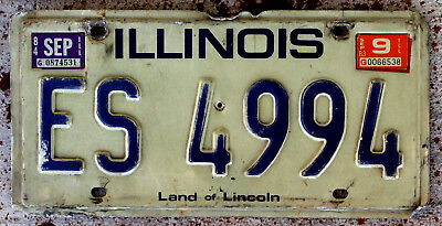 Blue on White 1979 Issue Illinois License Plate with a 1983 and a 1984 Sticker