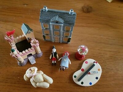 dolls house childrens toys and laptop