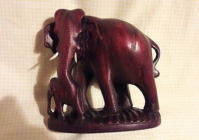 CARVED ELEPHANTS IN HARDWOOD 17.5 cms tall