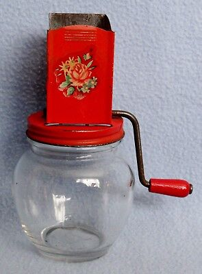 Vintage nut grater with red lid and decal Anchor Hocking glass jar