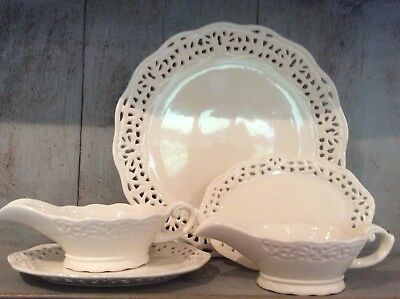 Cream Ware Pierced Serving Platter And Two Gravy Jugs With Saucers
