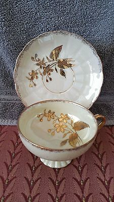 Antique  Footed Porcelain Cup & Saucer Bone Color w/ Raised Gold Flowers/Leaves