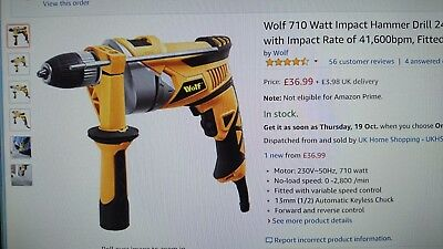 Wolf 710 Watt Impact Corded Hammer Drill. Auto keyless chuck, variable speed