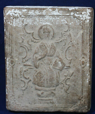 A Renaissance or Medieval ? pottery tile with relief decoration