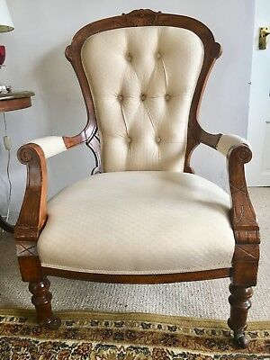 Victorian button-back mahogany carved cream fireside armchair