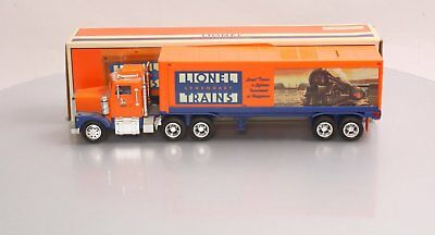 Lionel TMT-18018 Box Trailer Truck with Operating Lights, Sounds, Coinbank NIB