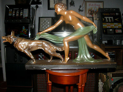 A Art Deco Of Naked Lady With Dog. 75Cm Long And 40 Cm High.
