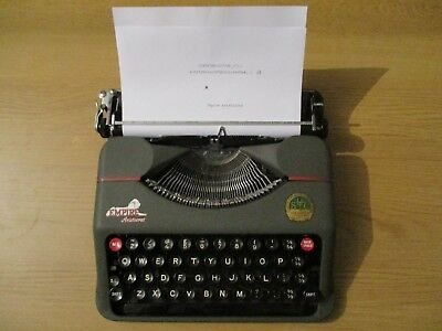 Vintage 1950s Empire Aristocrat portable typewriter with case and field bag