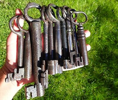 Ten enormous and heavy ancient wrought iron keys